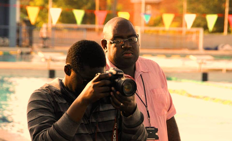 Producer Donald Oliver paying close attention to his director of photography Jason Sawyers in action