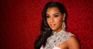 Sharlene Radlein, Miss Universe Jamaica 2015 poses in her evening gown upon arriving