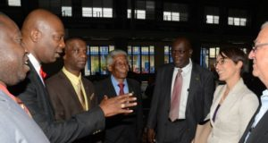 Foreign Affairs and Foreign Trade Minister, Senator the Hon. Kamina Johnson Smith (second right), having a light exchange with Chairperson of the Jamaica Diaspora Education Task Force, Leo Gilling (second left), on the first of the two-day 2nd Biennial Advancement in Education Summit at Jamaica College, on Old Hope Road in Kingston, on March 23. Others (from left) are: President of the Jamaica Teachers' Association (JTA), Norman Allen; President of the Mico University College, Dr. Ashburn Pinnock; Executive Director of the Jamaica Diaspora Institute, Professor Neville Ying; Education, Youth and Information Minister, Senator the Hon. Ruel Reid and Opposition Spokesperson on Education and Training, Rev. Ronald Thwaites.