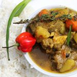 Jamaican Curried Goat with plain rice. via iamchefcunny